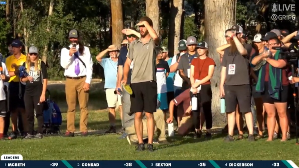 James Conrad lines up his 247-foot shot for birdie at the Disc Golf World Championship on...