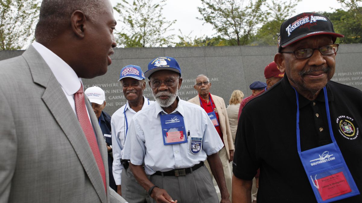 In this Aug. 3, 2011, file photo, Harry E. Johnson Sr., left, president & CEO of the Martin...