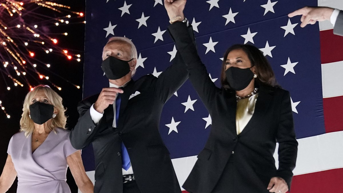 Democratic presidential candidate former Vice President Joe Biden raises his arm with his...
