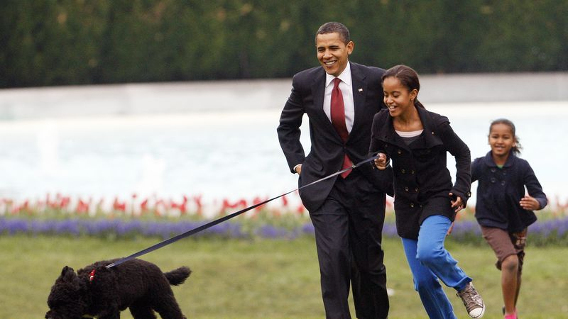 FILE - In this April 14, 2009, file photo Malia Obama runs with Bo, followed by President...