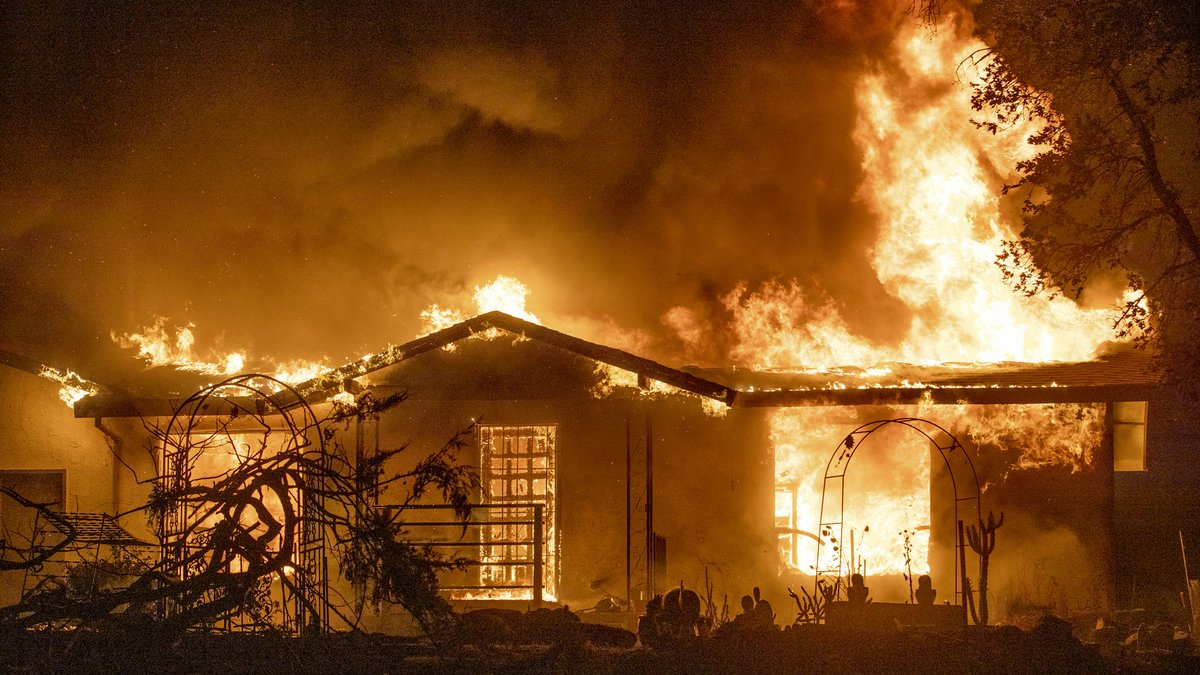 In this Sept. 27, 2020, file photo, a house burns on Platina Road at the Zogg Fire near Ono,...