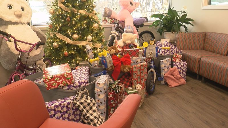 A deep pile of presents awaits a family in the offices of White's Travel Center in Rockbridge...