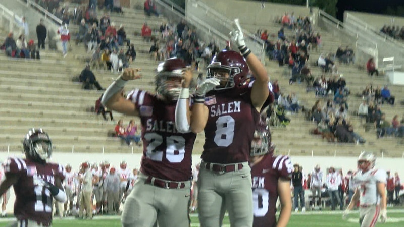 Salem's Cam Leftwich (left) celebrates with Chase Greer after scoring a touchdown in the second...