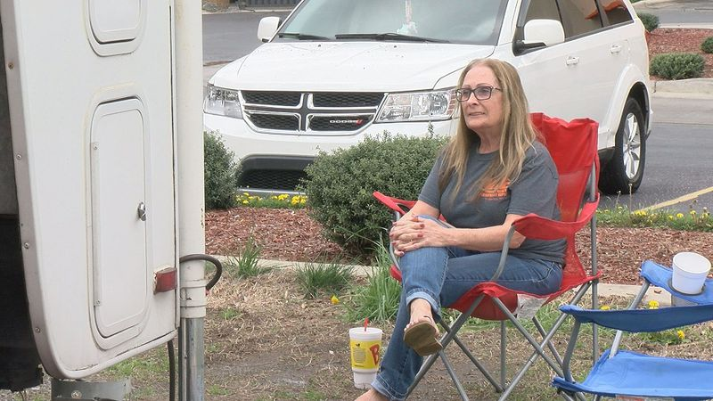 Vicki Weaver camps out with her family at a gas station for this weekend's races.