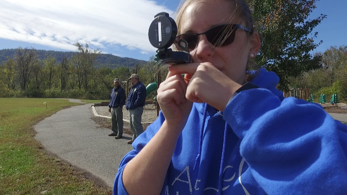Lord Botetourt High School student, Faith Settle, is competing in the compass-reading section of the forestry contest.