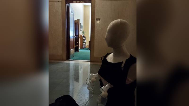 A mannequin with breast pumps sits outside the office of Nebraska state Sen. Dan Hughes on...
