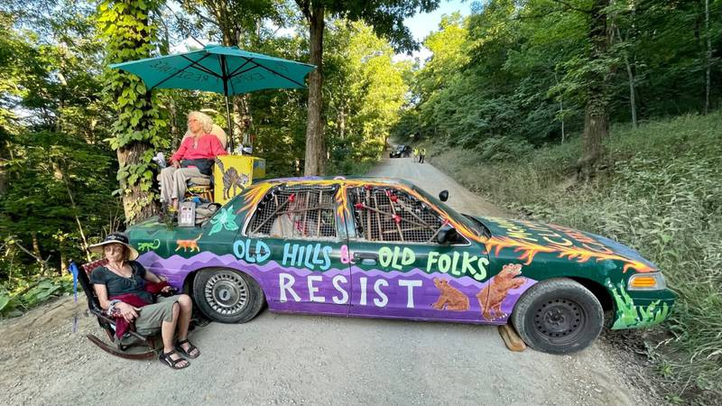 Opponents of the Mountain Valley Pipeline locked themselves to a car Wednesday morning,...