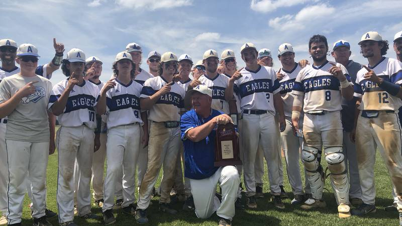 The Auburn High School baseball team poses with the trophy after defeating Essex 5-2 for the...