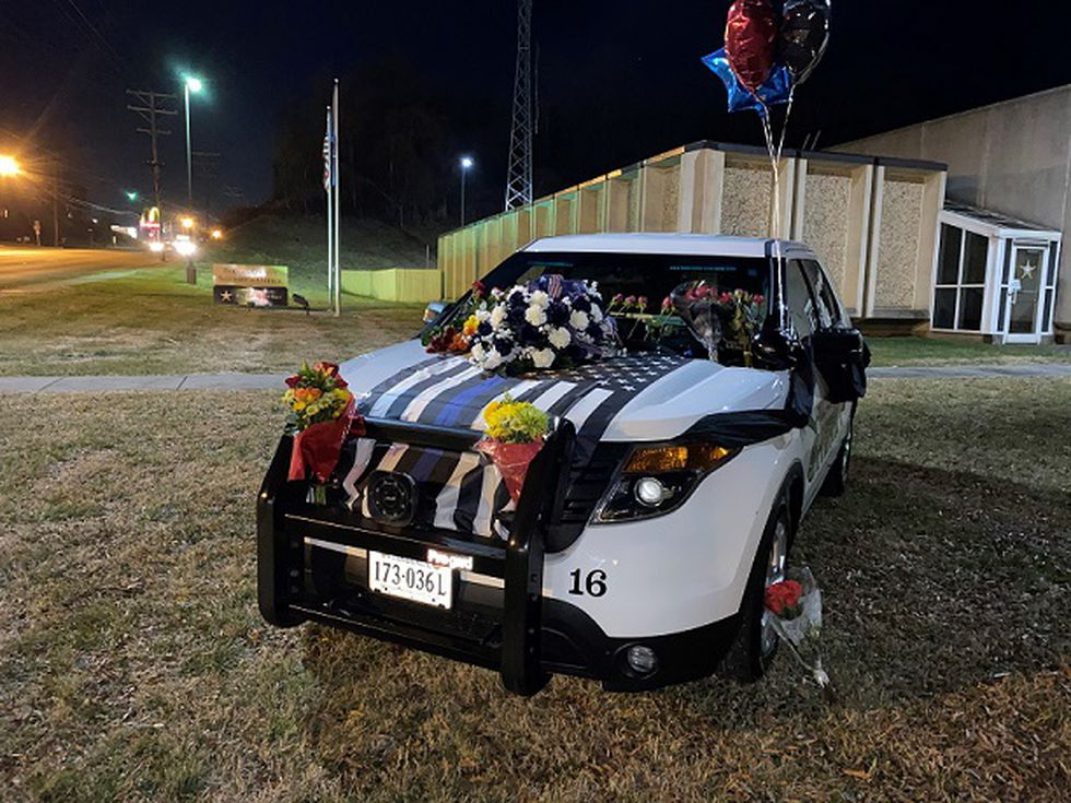Memorial in honor of Pulaski Sheriff's Sgt. Perry Hodge, killed in a crash Thursday. This is in...