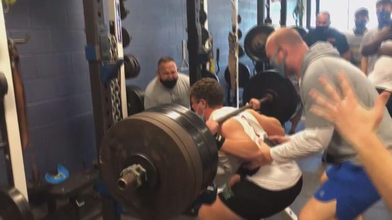 Blacksburg football players participate in max squat lifts during 'Squatober.'