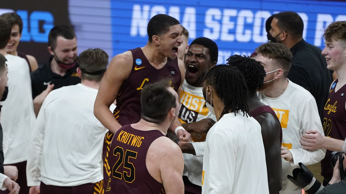 Loyola Chicago guard Lucas Williamson (1) celebrates after beating Illinois 71-58 after a men's...