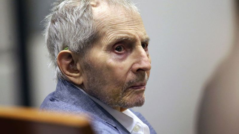 In this March 10, 2020, file photo, real estate heir Robert Durst looks over during his murder...