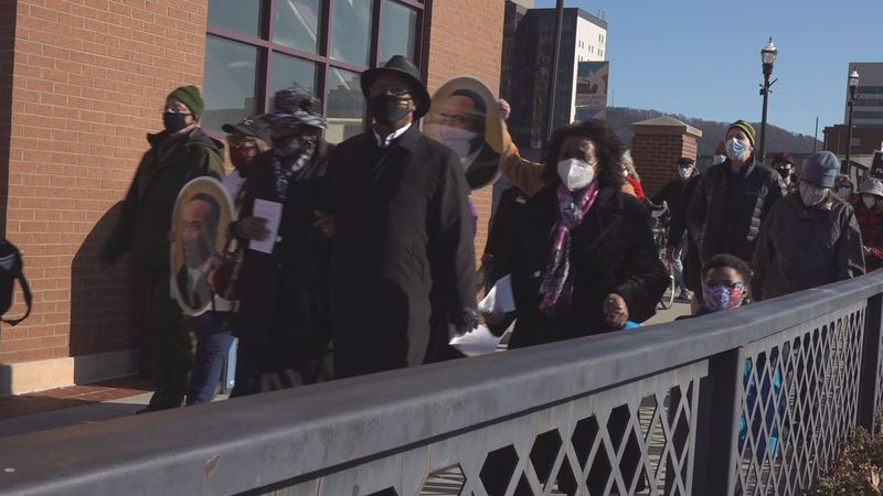 People marched across the Martin Luther King, Jr. Memorial Bridge in Roanoke to mark the...