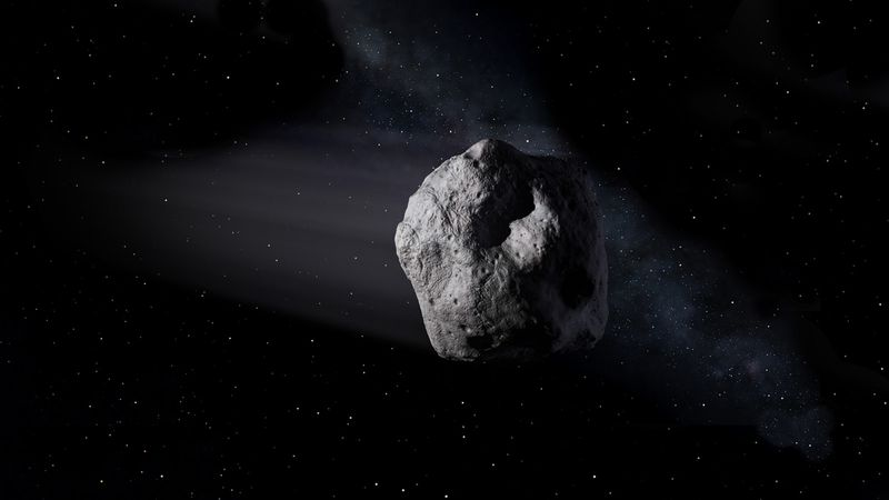 An illustration of the asteroid traveling through space.