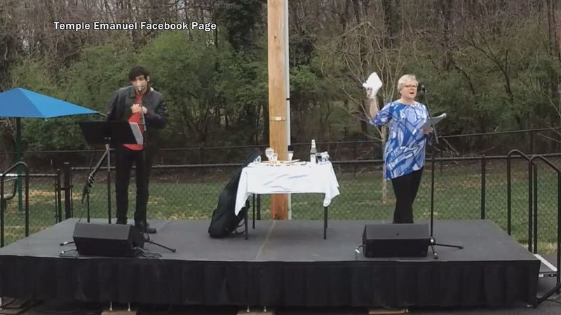 Temple Emanuel Rabbi Kathy Cohen held up Matzo at the outdoor Seder in the temple parking lot...