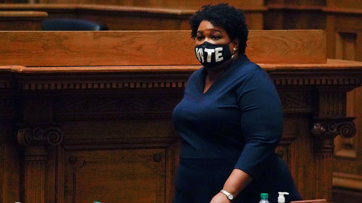 Democrat Stacey Abrams, walks on Senate floor before of members of Georgia's Electoral College...