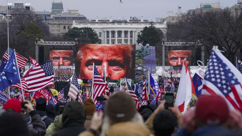 FILE - In this Jan. 6, 2021 file photo, Trump supporters participate in a rally in Washington....