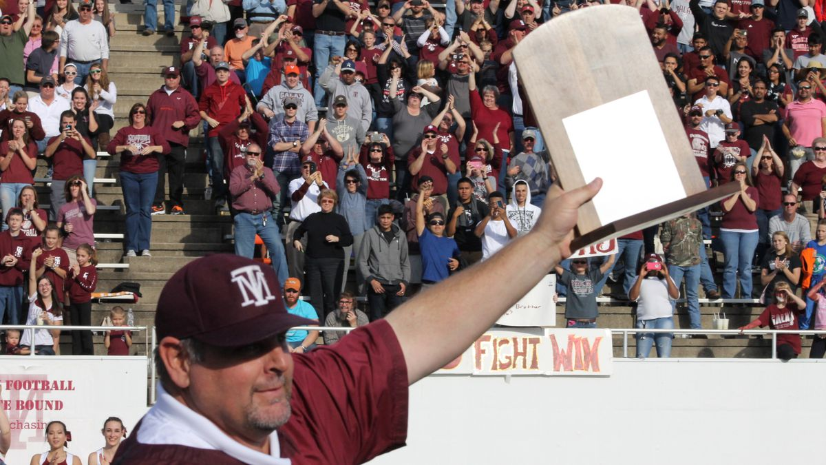 Galax football coach Mark Dixon celebrates the team's 2015 state championship.