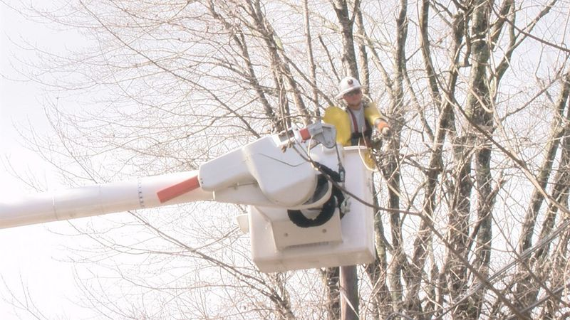 Crews replace wires that broke due to the ice storm.