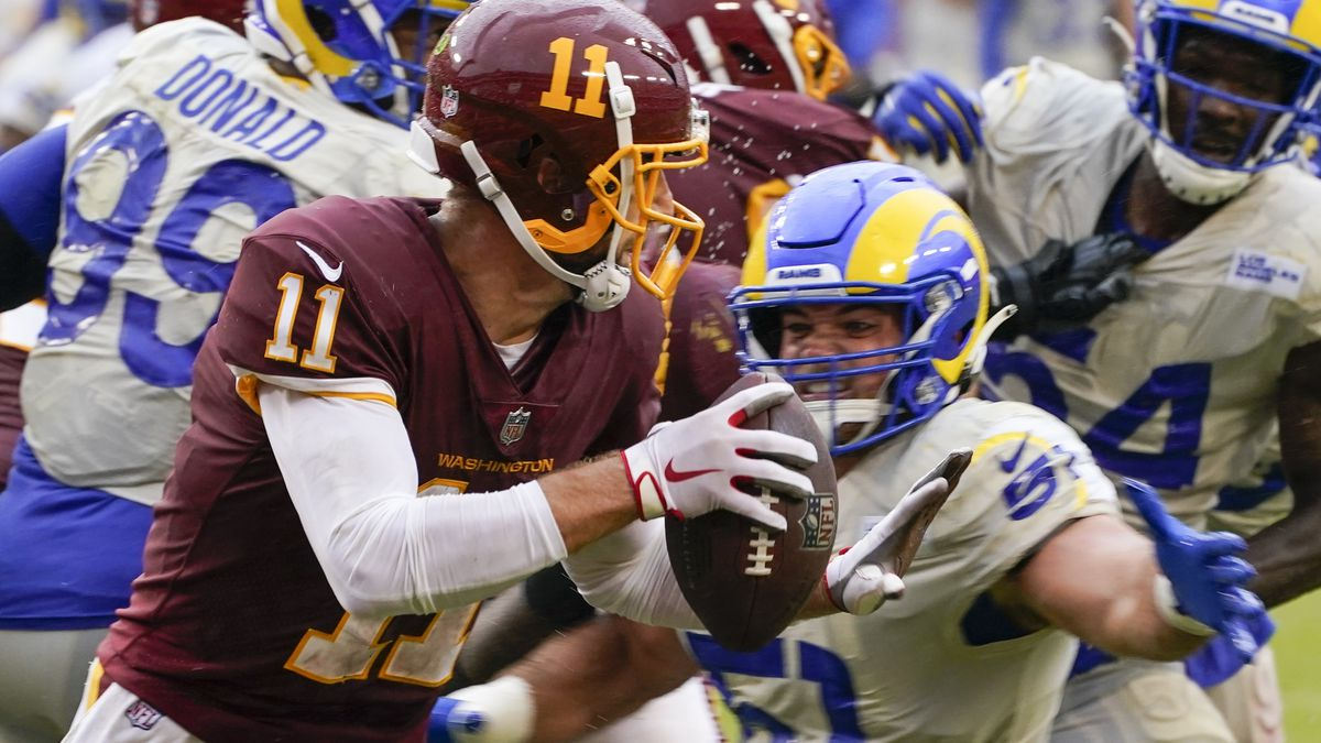 Washington Football Team's Alex Smith tries to get away from Los Angeles Rams' Troy Reeder during the second half of an NFL football game Sunday, Oct. 11, 2020, in Landover, Md. (AP Photo/Steve Helber)