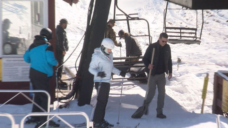 Skiers board the chair lift at the Omni Homestead resort.