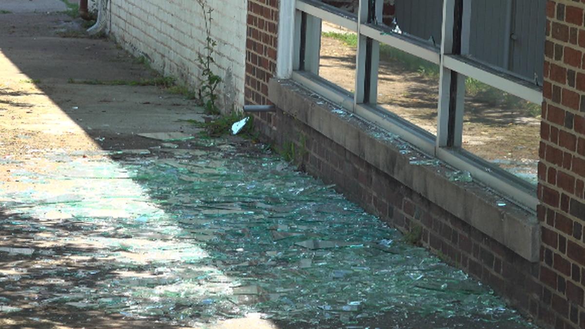 Glass was broken at the Adams Motor Company in Lynchburg. WDBJ7 photo.