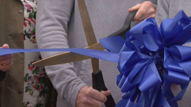 Owner Red Dowdell cuts the ribbon to open Rockbridge Barbell on Main Street in Lexington, Va.