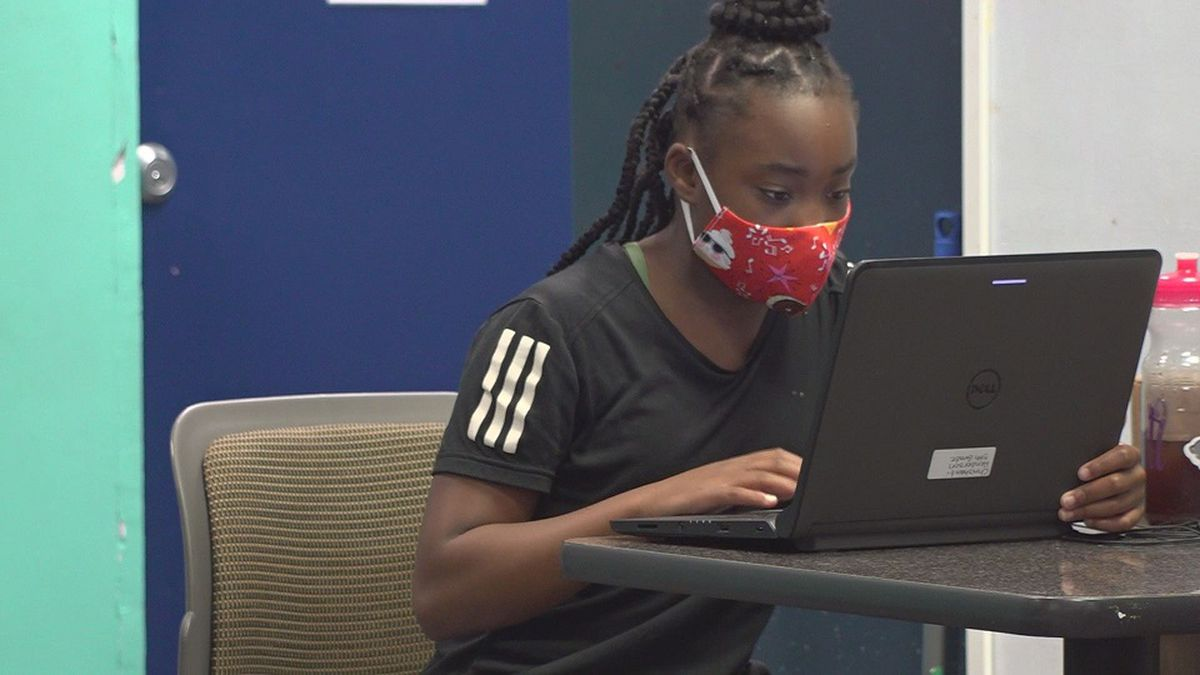 A student studies while at a Boys and Girls Club site..