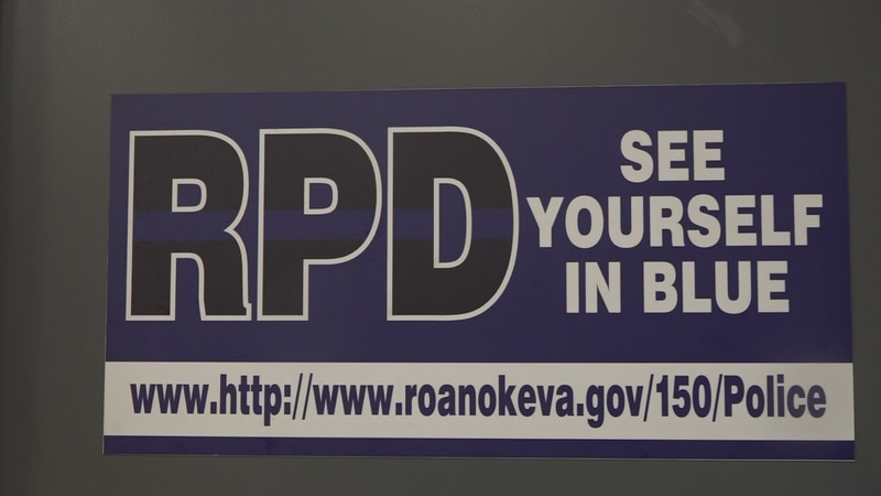 A sign encouraging the community to join the Roanoke Police Department.