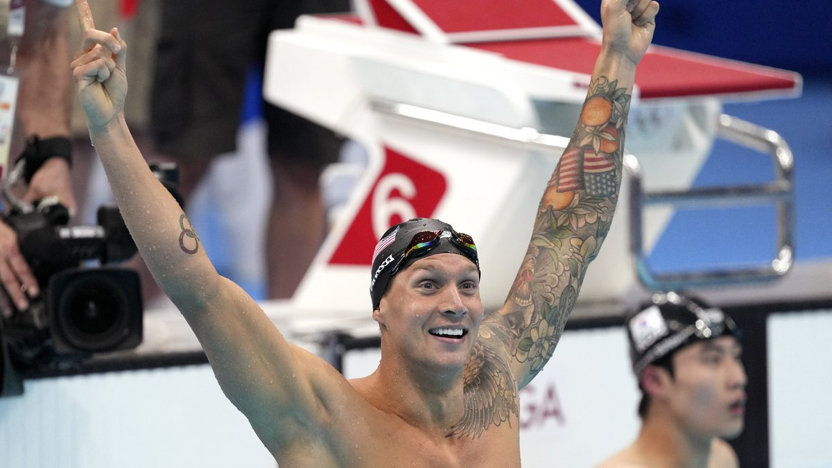 Caeleb Dressel of the United States celebrates winning the men's 100-meter freestyle final at...