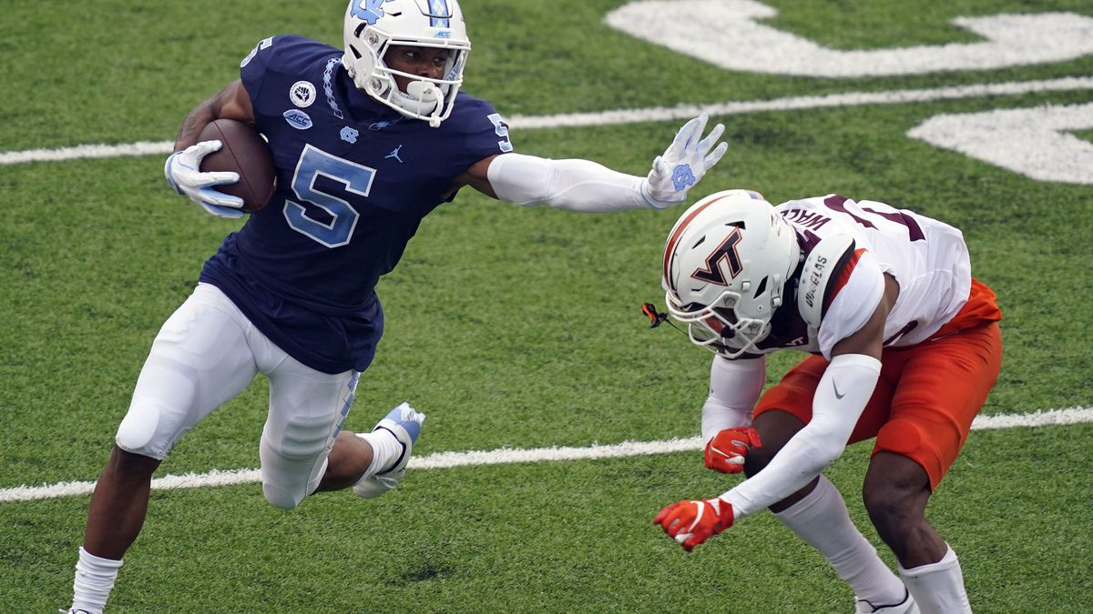 North Carolina wide receiver Dazz Newsome (5) finds some running room against Virginia Tech defensive back Jermaine Waller during the first half of an NCAA college football game in Chapel Hill, N.C., Saturday, Oct. 10, 2020. (AP Photo/Gerry Broome)