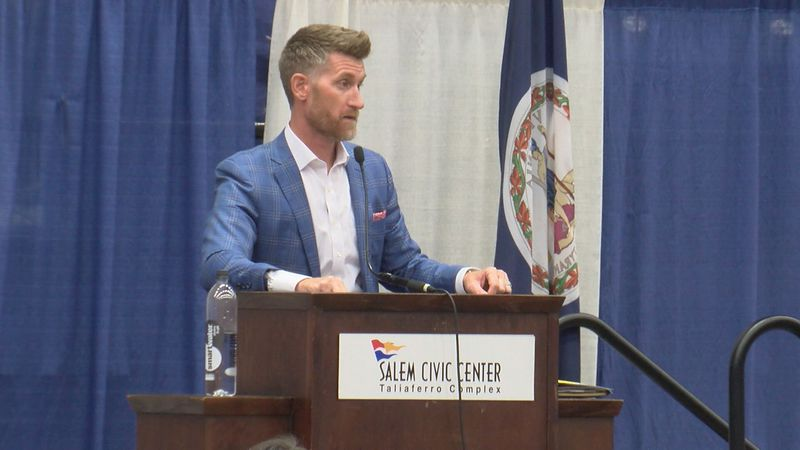 Marty Smith speaks at Roanoke Valley Sports Club this summer