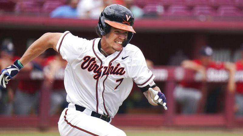 Virginia's Devin Ortiz runs to first during an NCAA college baseball tournament super regional...