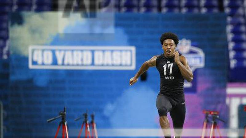 Liberty wide receiver Antonio Gandy-Golden runs the 40-yard dash at the NFL football scouting...