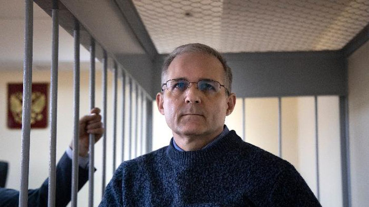Paul Whelan, a former U.S. marine, who was arrested for alleged spying in Moscow at the end of 2018, stands in a cage while waiting for a hearing in a court room in Moscow, Russia, Friday, Aug. 23, 2019. (AP Photo/Alexander Zemlianichenko)