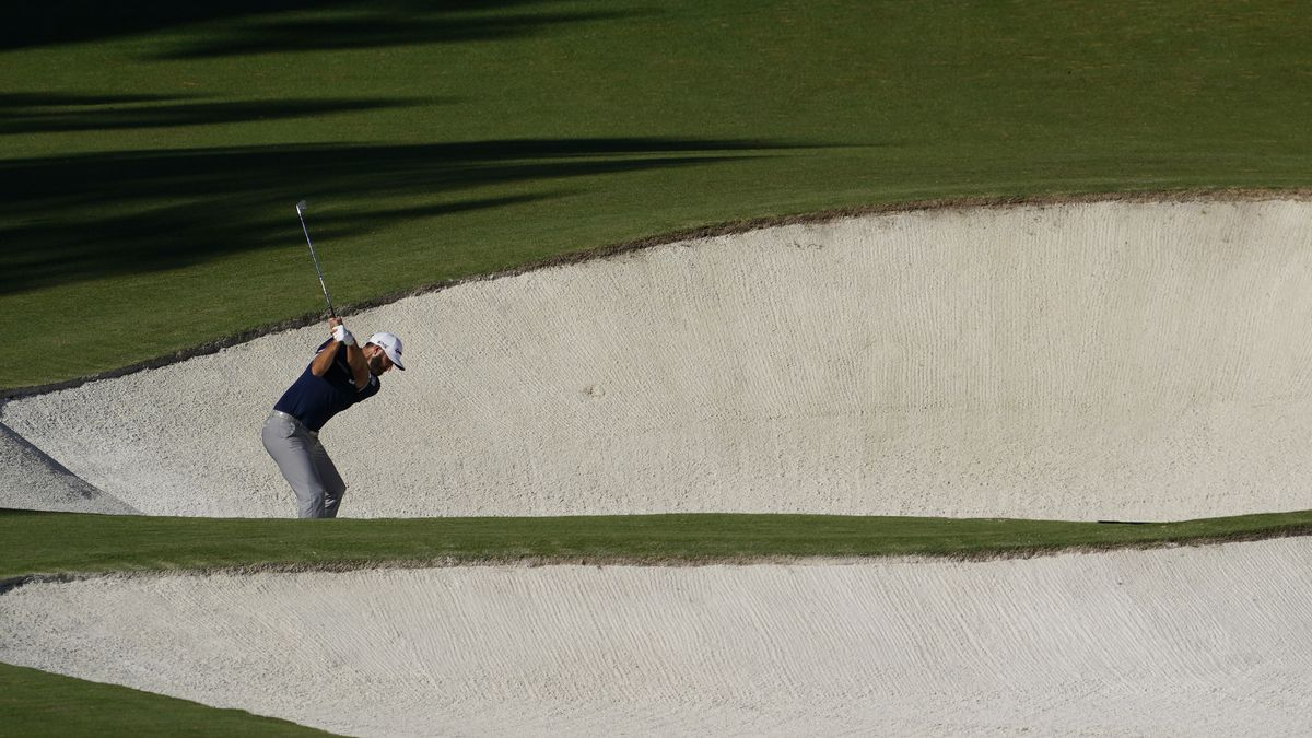 Dustin Johnson hits out of a bunker on the eighth hole during the second round of the Masters...