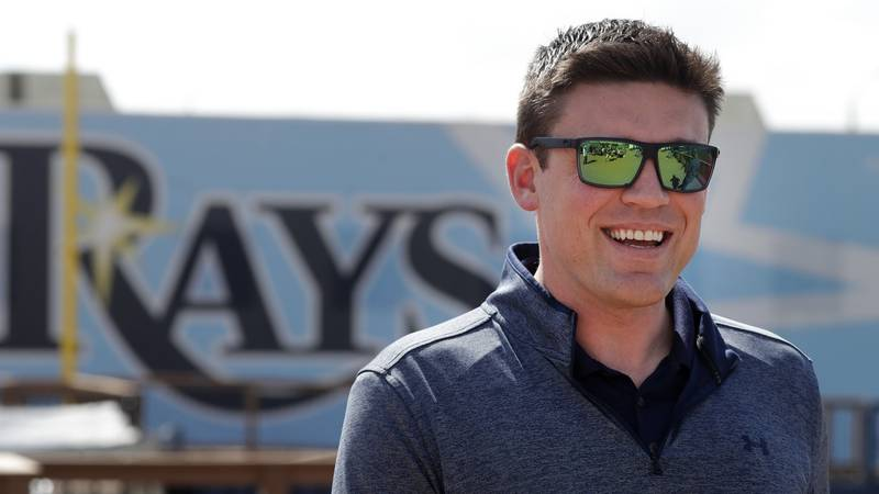 Tampa Bay Rays general manger Erik Neander, walks to a news conference after pitchers and...