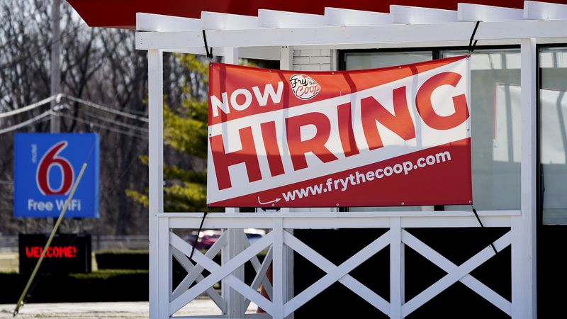 FILE - In this March 21, 2021 file photo, a hiring sign shows outside of restaurant in Prospect...