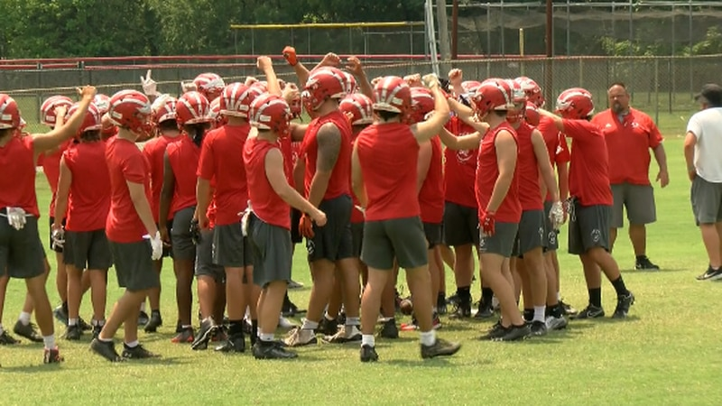 The Lord Botetourt Cavaliers break the huddle in practice