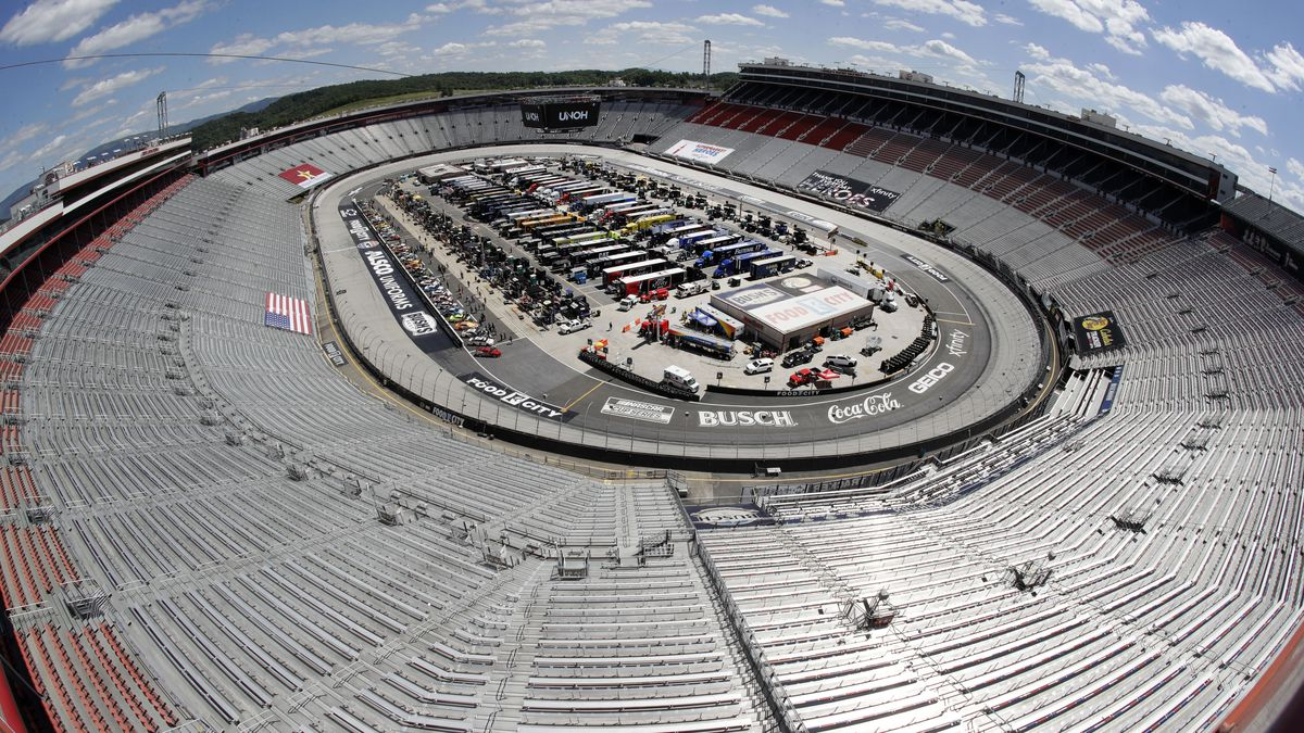 The stands sit empty as drivers prepare for the start of a NASCAR Cup Series auto race at...
