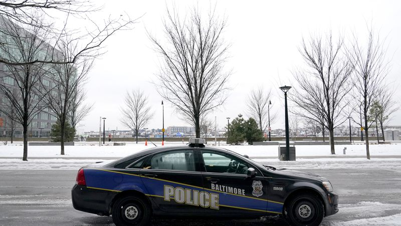 FILE - In this Thursday, Feb. 18, 2021, file photo, a Baltimore police cruiser is seen parked...