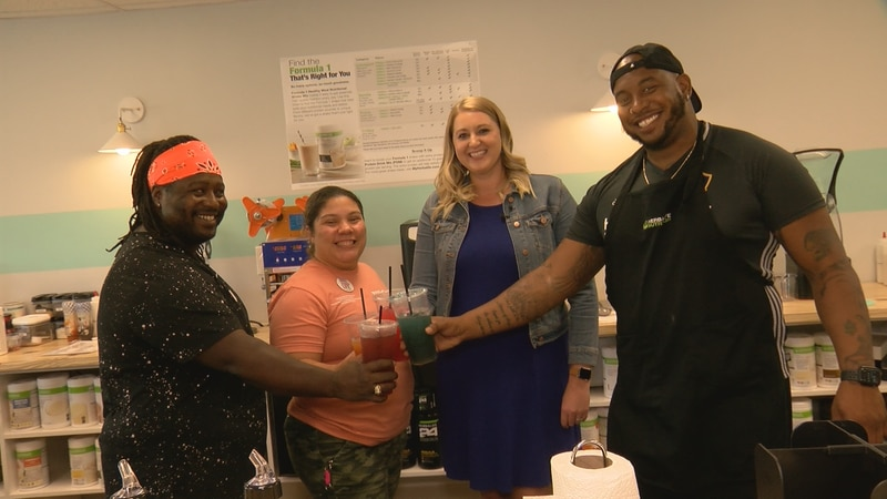 WDBJ7's Katey Roshetko raises a toast with the owners of Peak Energy and Nutrition in Roanoke.