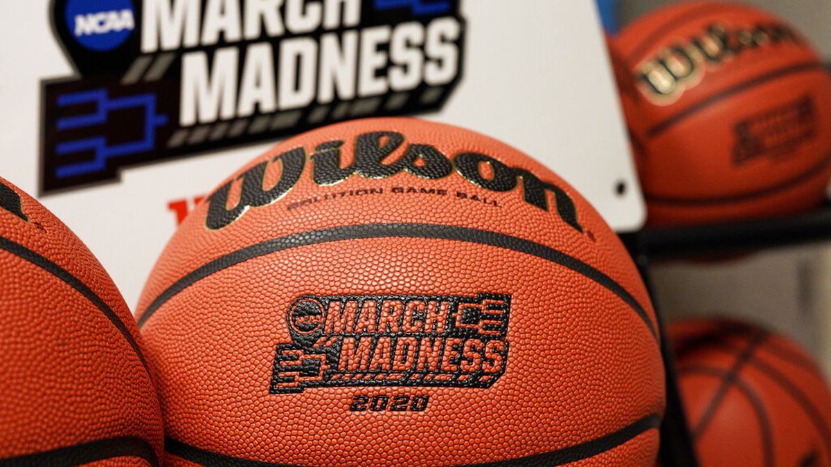 In this March 16, 2020, file photo, official March Madness 2020 tournament basketballs are...