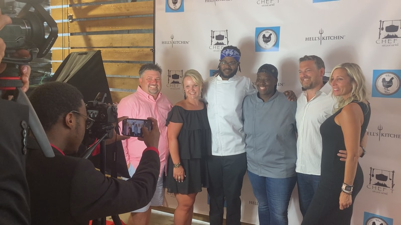Hell's Kitchen competitors, Chef T and Chef Steve Glenn, pose with friends and fans of the show...