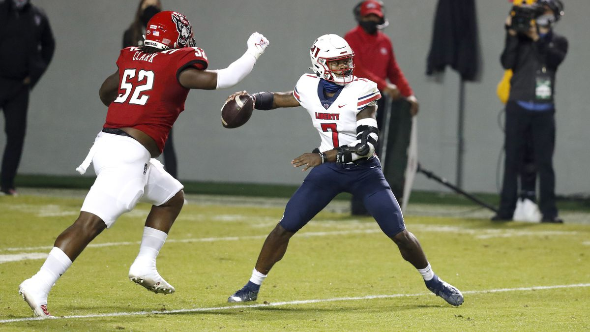 Liberty quarterback Malik Willis (7) prepares to pass as North Carolina State defensive tackle...