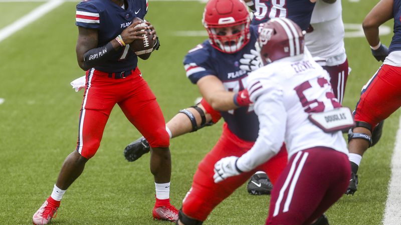 Liberty quarterback Malik Willis (7) looks to make a pass during the first half of a NCAA...