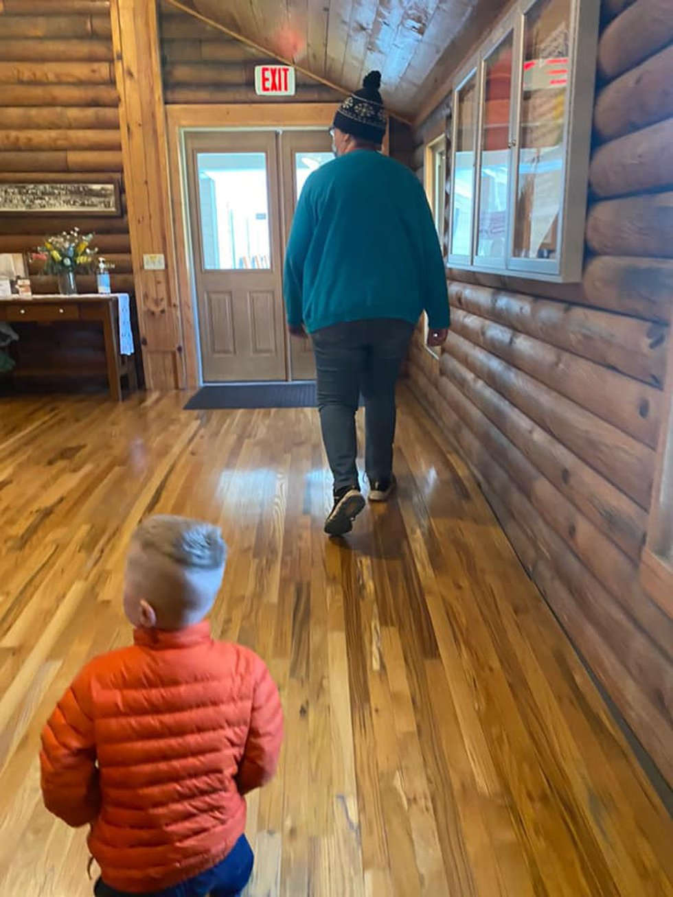The photo shows the female suspect leading Noah out of the nursery on May 2, 2021 (Giles County...