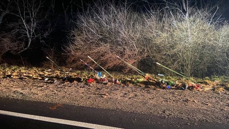 A roadside memorial for Sgt. Perry Hodge on Rt. 211, which included flags, appears to have been...
