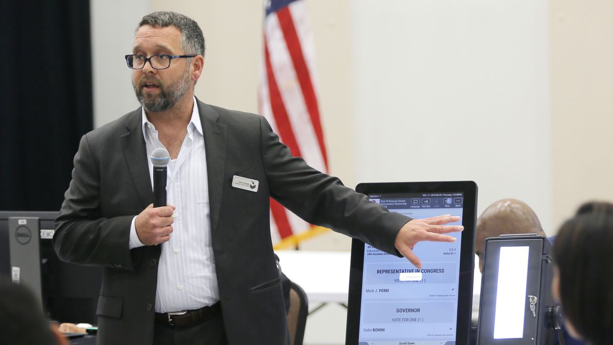In this  Thursday, Aug. 30, 2018 file photo, Eric Coomer from Dominion Voting demonstrates his...