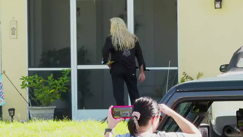 Dog the Bounty Hunter appeared at Brian Laundrie's parents' house on Saturday.